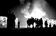 Bonfires on Shankhill Road Belfast on the night before the marching season Northern Ireland 1990's