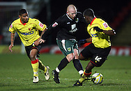 London - Wednesday, December 12th, 2008: Liam Bridcutt (left) and Lloyd Doyley of Watford and Matty Pattison of Norwich City during the Coca Cola Championship match at Vicarage Road, London. (Pic by Chris Ratcliffe/Focus Images)