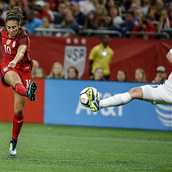 Oct 19, 2017; New Orleans, LA, USA; USA midfielder Carli Lloyd (10) has a shot blocked by Korea Republic Ji Sunmi (13) during the second half of an International Friendly Women's Soccer match at the Mercedes-Benz Superdome. Mandatory Credit: Derick E. Hingle-USA TODAY Sports