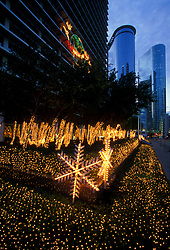 Stock photo of Christmas lights decorating the landscaping outside of a downtown Houston office building