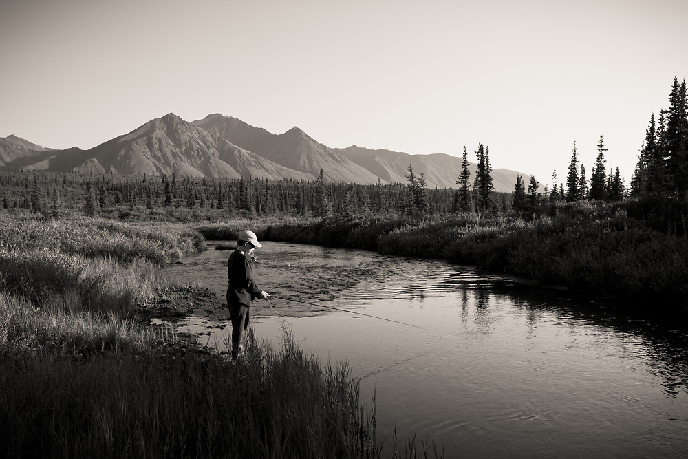 Callahan Rogers (eight years old) fly fishing for grayling in a small tundra stream in the Alaskan interior.