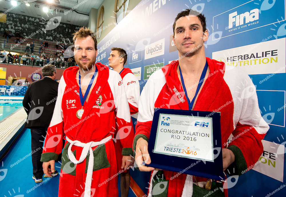 On the right Daniel Varga captain of Team Hungary awarded for Olympic qualification, first qualified <br /> FINA Men's Water polo Olympic Games Qualifications Tournament 2016<br /> Final 1st place<br /> Hungary HUN (White) Vs Italy ITA (Blue)<br /> Trieste, Italy - Swimming Pool Bruno Bianchi<br /> Day 08  10-04-2016<br /> Photo G.Scala/Insidefoto/Deepbluemedia