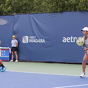 August 23, 2014, New Haven, CT:<br /> Ena and Shuhei Shibahara  play during the US Open National Playoffs mixed doubles finals against Jacqueline Cako and Joel Kielbowicz on day nine of the 2014 Connecticut Open at the Yale University Tennis Center in New Haven, Connecticut Saturday, August 23, 2014.<br /> (Photo by Billie Weiss/Connecticut Open)