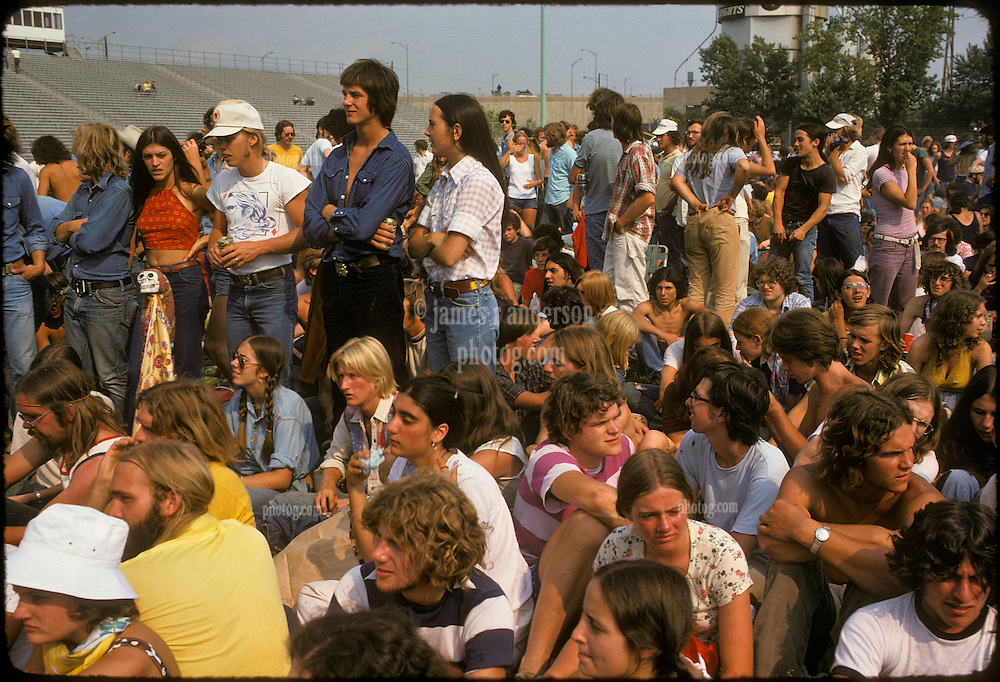 Concert Fans, and for sure a few Deadheads. Waiting for the show. These are the Folks at Dillon Stadium, in place waiting for the Grateful Dead to  Play Live at Hartford, CT on 31 July 1974. <br /> Study this Photograph, this Moment, these People are either us, or deceased. I insist we wont be deceased as a friend gathering