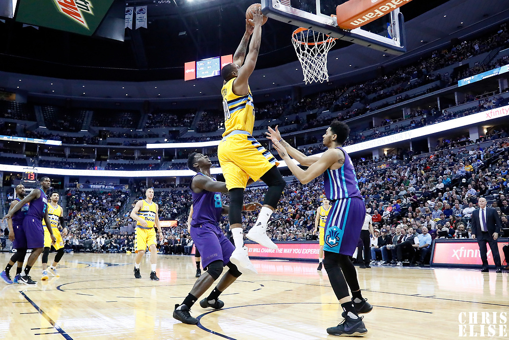 04 March 2017: Denver Nuggets forward Darrell Arthur (00) goes for the dunk during the Charlotte Hornets 112-102 victory over the Denver Nuggets, at the Pepsi Center, Denver, Colorado, USA.