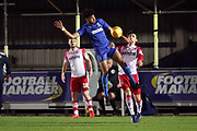 AFC Wimbledon midfielder Tyler Burey (32) battles for possession during the EFL Trophy group stage match between AFC Wimbledon and Stevenage at the Cherry Red Records Stadium, Kingston, England on 6 November 2018.