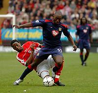 Fotball<br /> Photo. Glyn Thomas, Digitalsport<br /> Norway Only<br /> <br /> Charlton Athletic v Portsmouth. FA Barclaycard Premiership. <br /> The Valley, Charlton, London. 10/04/2004.<br /> Charlton's Jason Euell (L) brings down Portsmouth's Lomano Lua Lua.