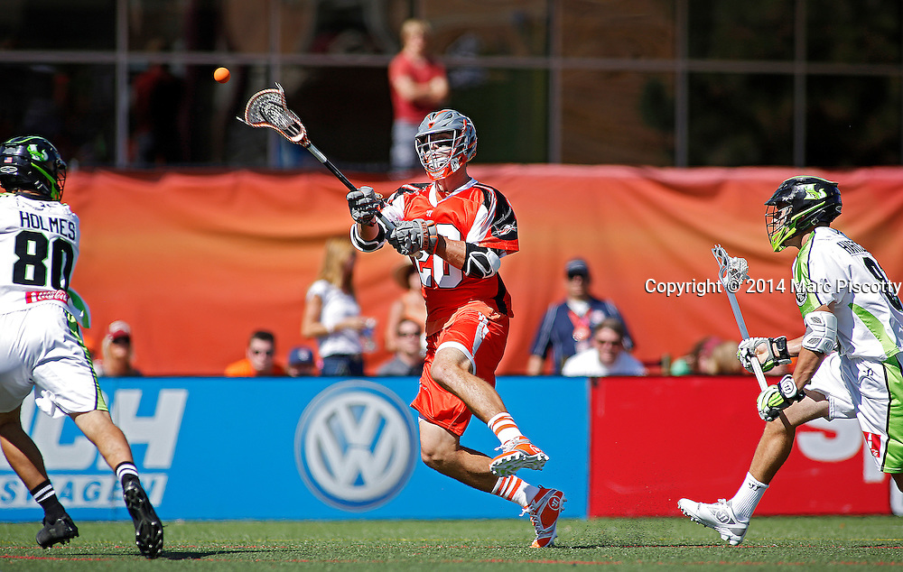 SHOT 8/16/14 3:30:26 PM - The Denver Outlaws Jeremy Sieverts #20 takes an off balance shot on net against the New York Lizards during their MLL Semifinals matchup at Peter Barton Lacrosse Stadium on the University of Denver campus in Denver, Co. Saturday. The Denver Outlaws won the game 14-13 to advance on a game winning goal by Sieverts in the closing minutes. (Photo by Marc Piscotty / © 2014)