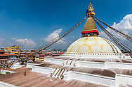 A monk takes a moment of solitude on the first level of the stupa at Boudhanath, Kathmandu, Nepal.