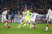 Lionel Messi of Barcelona and Aouar Houssem of Lyon and Terrier Martin of Lyon during the UEFA Champions League, round of 16, 1st leg football match between Olympique Lyonnais and FC Barcelona on February 19, 2019 at Groupama stadium in Decines-Charpieu near Lyon, France - Photo Romain Biard / Isports / ProSportsImages / DPPI