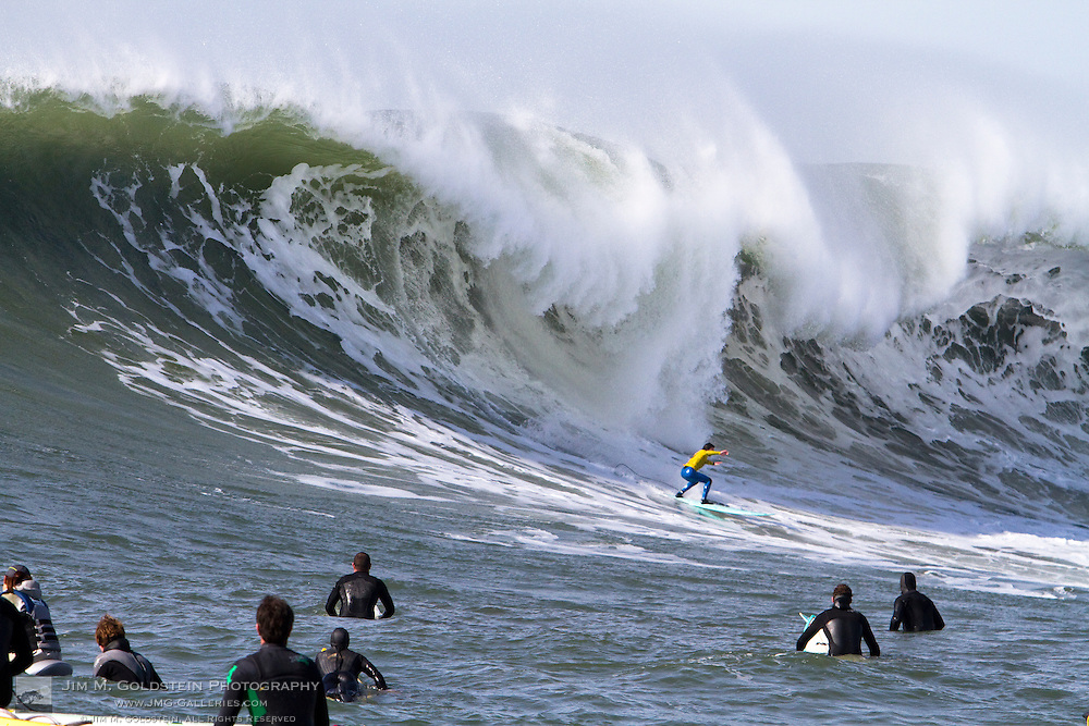 Shane Desmond, second place finisher at the 2010 Mavericks Surf Contest, drops into a giant wave during the finals - Half Moon Bay, California - February 13, 2010