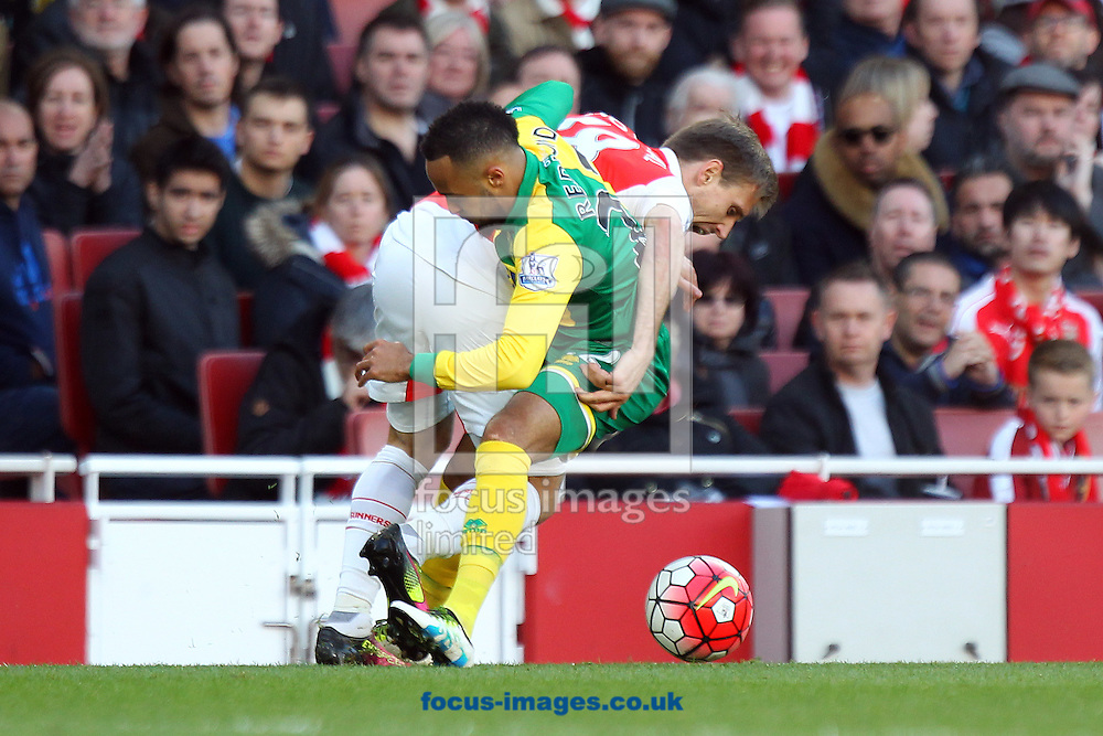 Nathan Redmond of Norwich and Nacho Monreal of Arsenal in action during the Barclays Premier League match at the Emirates Stadium, London, UK.<br /> Picture by Paul Chesterton/Focus Images Ltd +44 7904 640267<br /> 30/04/2016