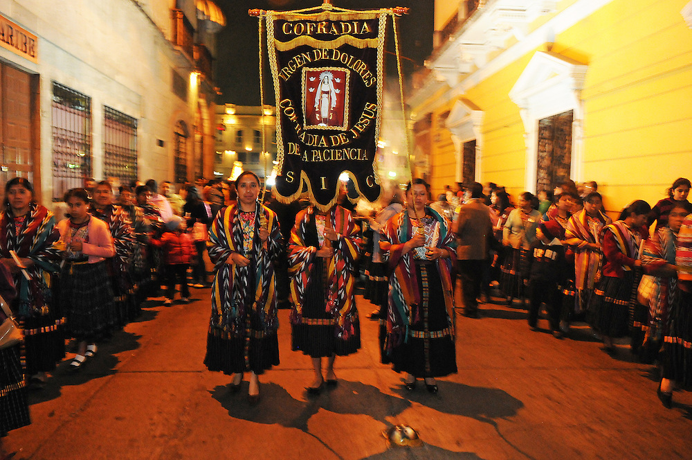 Apr 19, 2011 - Quetzaltenago, Guatemala -  Flag bearers dressed in Traditional Guatemalan clothing with the Procession of Jesus De LA Paciencia march down fourth calle Tuesday night. The procession is one of many that will take place during Semana Santa or Holy Week in Guatemala, which runs from Palm Sunday to Holy Saturday..(Credit Image: © Josh Bachman/ZUMA Press)