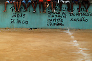 Youths attend a soccer game during a tournament at the Sao Carlos slum in Rio de Janeiro June 7, 2014. Photo/Pilar Olivares (BRAZIL)