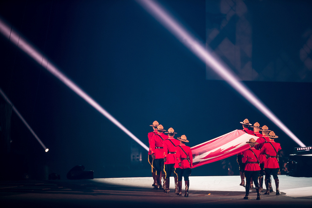 Members of the Royal Canadian Mounted Police carry in the Canadian flag during the opening ceremonies at the 2015 Pan American Games in Toronto, Canada, July 10,  2015.  AFP PHOTO/GEOFF ROBINS