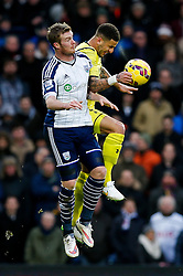 Chris Brunt of West Brom and Kyle Walker of Tottenham Hotspur compete in the air - Photo mandatory by-line: Rogan Thomson/JMP - 07966 386802 - 31/01/2015 - SPORT - FOOTBALL - West Bromwich, England - The Hawthorns - West Bromwich Albion v Tottenham Hotspur - Barclays Premier League.