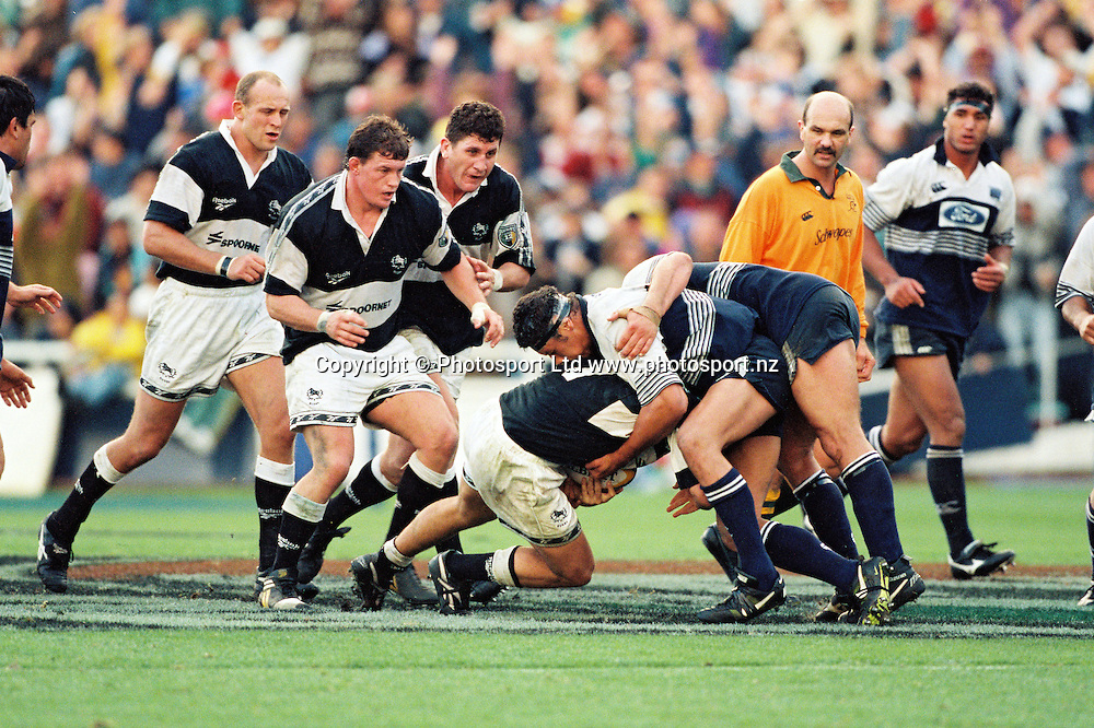 Charles Riechelmann of the Blues defends an attack by the Sharks.<br /> Super 12 Rugby final between the Auckland Blues and Natal Sharks at Eden Park, Auckland, New Zealand on 25 May 1996.<br /> The Blues won the final 45-21.<br /> Copyright photo: www.photosport.nz