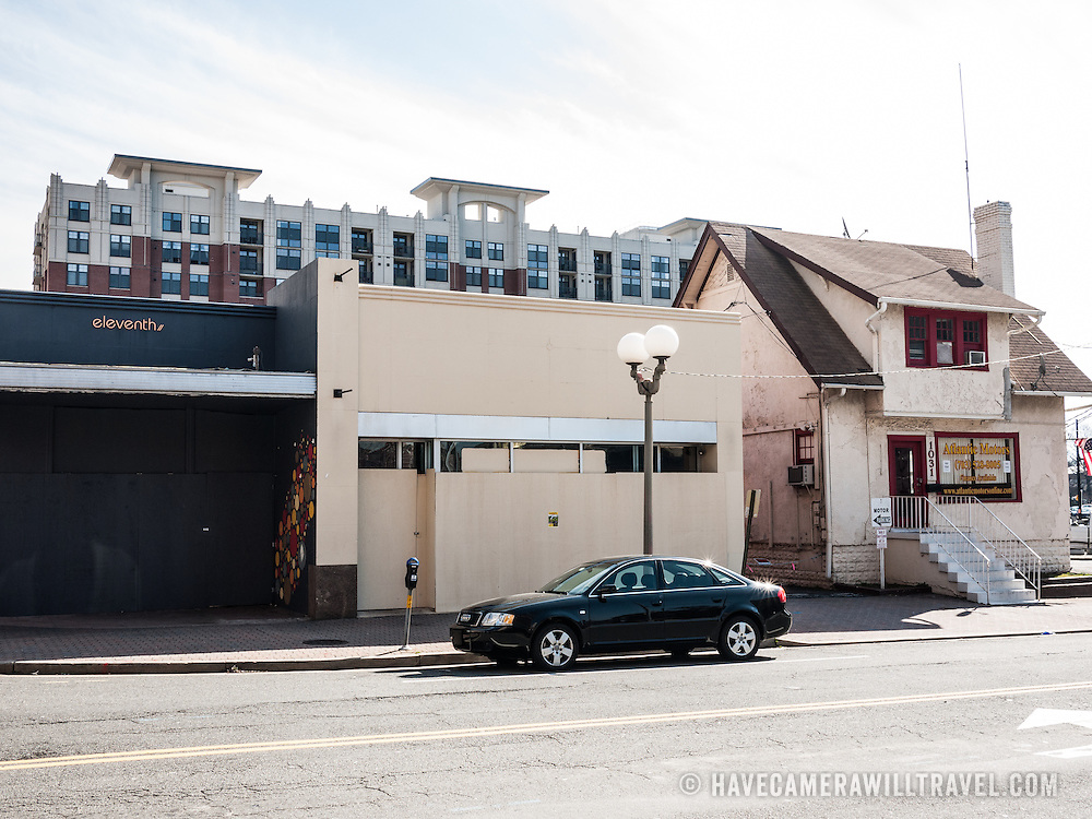 The shuttered buildings on N Highland St in Clarendon that used to be Eleventh bar, a U.S. Post Office (and then a Crossfit gym). Next to them, Atlantic Motors continues to operate.