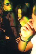 Oriental clubbers on the dancefloor, UK 2000's