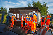 THe big switch on at an array of solar panels next to the line near Aldershot Railway Station.  This innovative project is the first in the UK to power the railway with electricity generated from solar power and, if successful, could see many Network Rail sites across the country adapting this sustainable energy approach. Riding Sunbeams is a social enterprise, run by 10:10 Climate Action. Built with Community Energy South and partnered with Network Rail and The Department for Transport and by InnovateUK.  Aldershot, Hampshire, United Kingdom. Riding Sunbeams is a world leading project to connect solar panels directly into electrified rail routes to power the trains. Direct supply of solar power to rail traction systems has never been done. But it has huge potential - from metros, trams and railways in the UK and around the world.<br /> (photo by Andy Aitchison / 1010 Climate Action)