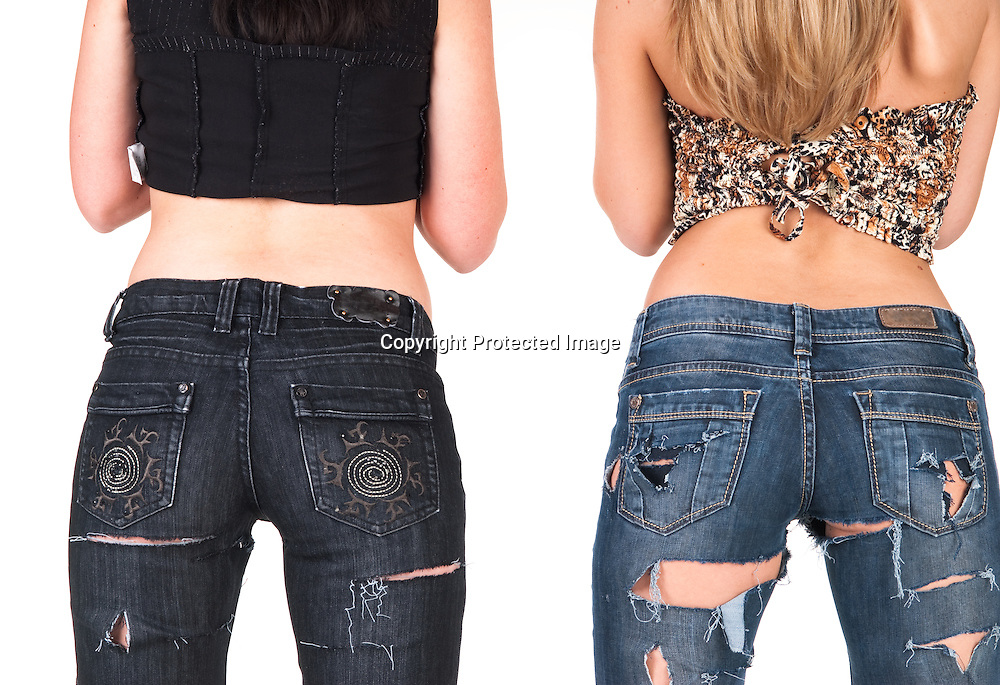 Backside of two girls in jeans