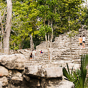 Steps of La Iglesia at Coba, an expansive Mayan site on Mexico's Yucatan Peninsula not far from the more famous Tulum ruins. Nestled between two lakes, Coba is estimated to have been home to at least 50,000 residents at its pre-Colombian peak.