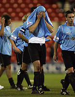 Photo: Paul Thomas.<br /> Nottingham Forest v Salisbury. The FA Cup. 12/12/2006.<br /> <br /> Dejected Salisbury players walk down to thank their travelling fans.