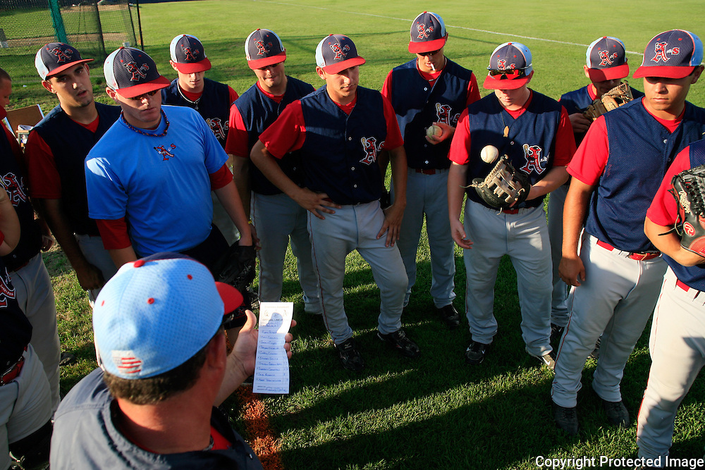 Clarinda A's manager Ryan Eberly gives the starting lineup and goes over game strategy before their game against the Omaha Diamond Spirit on July 26th, 2010.  photo by David Peterson