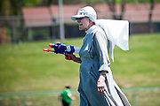 Sister uses a squirt gun at field day , May 20, 2014. (Photo by Lauren Justice)