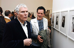 Left to right, GLENN O'BRIEN and artist ROBERT HAWKINS at a private view of 'Warhol's World' an exhibition of photography and Television by Andy Warhol held at Hauser & Wirth, Piccadilly, London on 26th January 2006.<br />