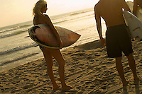 Young Woman Surfer on Beach