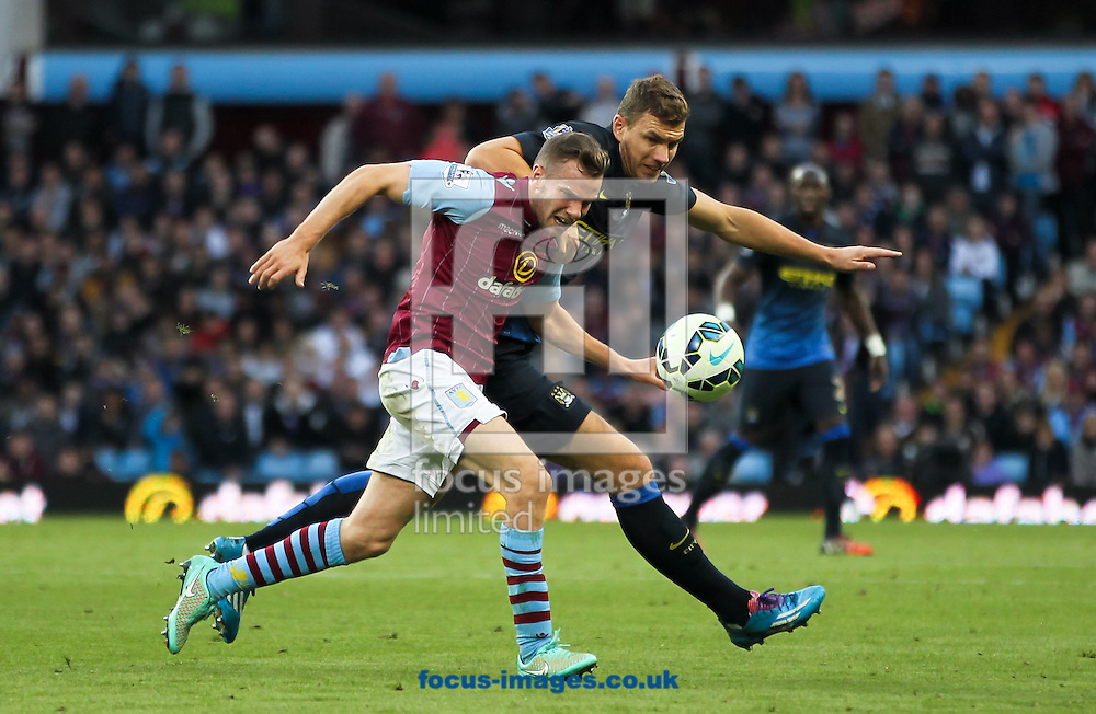 Tom Cleverley (left) of Aston Villa and Edin Džeko (right) of Manchester City battle for the ball during the Barclays Premier League match at Villa Park, Birmingham<br /> Picture by Tom Smith/Focus Images Ltd 07545141164<br /> 04/10/2014