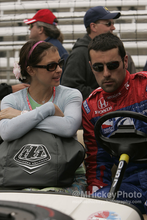 Ashely Judd and her husband Dario Franchitti talk during warm-ups prior to qualifications for the Indianapolis 500 Photo by Michael Hickey