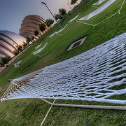 """Float"" temporary art installation - Hammocks on the lawn at the Kansas City Convention Center across from the Kauffman Center for the Performing Arts"
