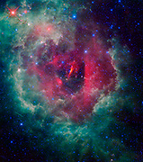 NASA's WISE shows the Rosette nebula located within the constellation Monoceros, or the Unicorn. This nebula, also known as NGC 2237, is a huge star-forming cloud of dust and gas in our Milky Way galaxy. Estimates of the nebula's distance vary from 4,500 to 5,000 light-years away.