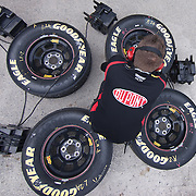 Jeff Gordon crew member sits on Good year tires Friday, May. 13, 2011 during NASCAR Sprint Cup Series practice race at Dover International Speedway in Dover Delaware.