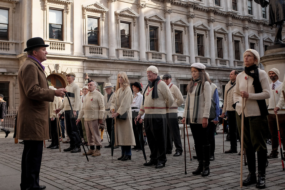 © Licensed to London News Pictures. 10/11/2017. London, UK. 24hrs ahead of Remembrance Day current members of the Chelsea Arts Club assemble and drill at The Royal Academy of Arts honoring their predecessors who in 1914 formed a corps called the United Arts Rifles, or the 'Unshrinkables' owing to their unorthodox dress before issue of uniform (made up largely of woollen cricket whites, advertised as 'unshrinkable'). They will parade once more in 2018, marking the end of the Great War. Photo credit: Guilhem Baker/LNP<br /> <br /> Royal Academy of Arts Unshrinkables Remembrance Parade.  Photo credit: PHOTOGRAPHERS NAME/LNP
