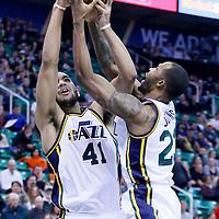 09 December 2015: Utah Jazz forward Trey Lyles (41) grabs a rebound with Utah Jazz forward Chris Johnson (23) during the Utah Jazz 106-85 victory over the New York Knicks, at the Vivint Smart Home Arena, Salt Lake City, Utah, USA.