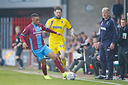 Scunthorpe United midfielder Funso Ojo (6) shields the ball from Wimbledon midfielder Anthony Wordsworth (40)   during the EFL Sky Bet League 1 match between Scunthorpe United and AFC Wimbledon at Glanford Park, Scunthorpe, England on 30 March 2019.