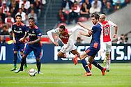 04-10-2015 VOETBAL: AJAX-PSV:AMSTERDAM<br /> Kenny Tete van Ajax gaat over het been van Davy Propper van PSV <br /> <br /> <br /> Foto: Geert van Erven
