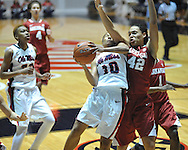 Ole Miss' Diara Moore (10) vs. Arkansas' Jhasmin Bowen (42) in a women's college basketball game in Oxford, Miss. on Thursday, January 31, 2013. Arkansas won 77-66.