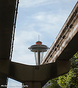 Under the Seattle monorail with views of the Space Needle and new skyscraper construction