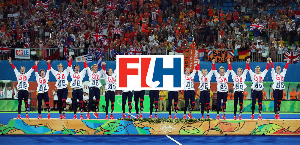 RIO DE JANEIRO, BRAZIL - AUGUST 19:  Team Great Britain pose on the podium during the medal ceremony after defeating Netherlands in the Women's Gold Medal Match on Day 14 of the Rio 2016 Olympic Games at the Olympic Hockey Centre at the Olympic Hockey Centre on August 19, 2016 in Rio de Janeiro, Brazil.  (Photo by Tom Pennington/Getty Images)