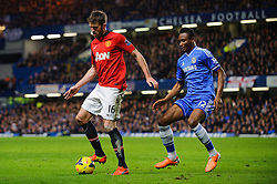 Man Utd Midfielder Michael Carrick (ENG) is challenged by Chelsea Midfielder Mikel John Obi (NGA) during the match - Photo mandatory by-line: Rogan Thomson/JMP - Tel: 07966 386802 - 19/01/2014 - SPORT - FOOTBALL - Stamford Bridge, London - Chelsea v Manchester United - Barclays Premier League.