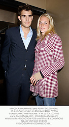 MR OSCAR HUMPHRIES and POPPY DELEVINGNE,  at a party in London on 23rd April 2003.	PIY 155