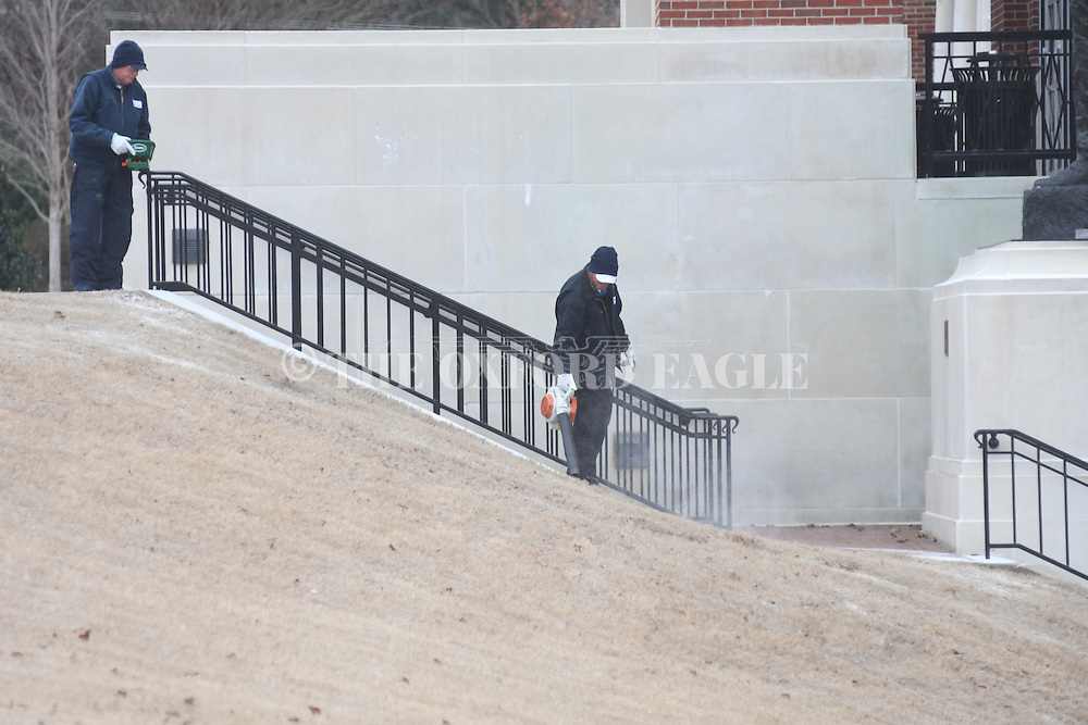 Snow is cleared from the steps outside the Gertrude C. Ford Center for the Performing Arts in Oxford, Miss. on Friday, January 6, 2017.  Oxford received a slight amount of snow this morning.