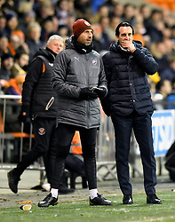 Arsenal manager Unai Emery (right) watches the action from the touchline during the Emirates FA Cup, third round match at Bloomfield Road, Blackpool.
