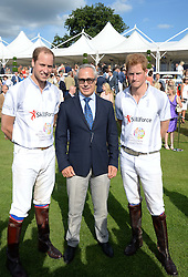 Left to right, HRH THE DUKE OF CAMBRIDGE, JON ZAMMETT and HRH PRINCE HARRY OF WALES at the Audi Polo Challenge 2013 at Coworth Park Polo Club, Berkshire on 3rd August 2013.