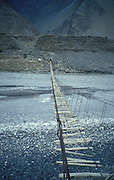 Gigantic suspension bridge in the karakorum mountains, near Passu on the Karakorum Highway, Northern Pakistan, asia
