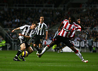 Photo: Andrew Unwin.<br /> Newcastle United v Sheffield United. The Barclays Premiership. 04/11/2006.<br /> Newcastle's James Milner (L) looks to turn past Sheffield United's Mikele Leigertwood (R).